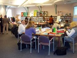 Group of teachers working in the media center