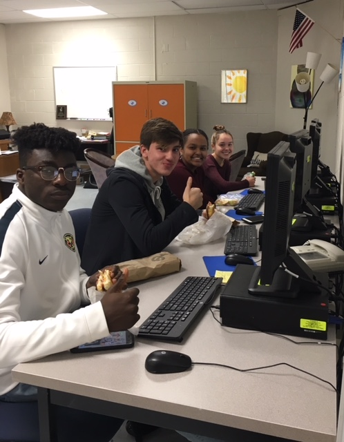 IB DP students eating lunch at computers