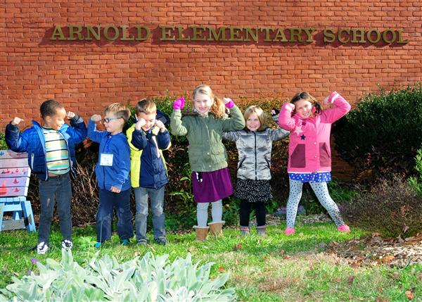 "Students under ""Arnold Elementary School"" sign"