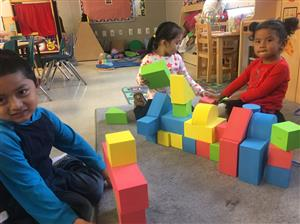 3 children playing with blocks