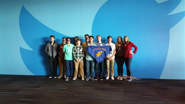 Students in front of the Twitter logo holding Severna Park High banner.
