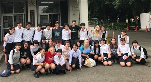 SigStudents in front of Sagamihara HS in Japan with their host students!