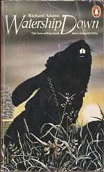 Watership Down, by Richard Adams. A book cover showing a rabbit in silhouette who appears to be wearing a chain, while sitting in the grass during sunset
