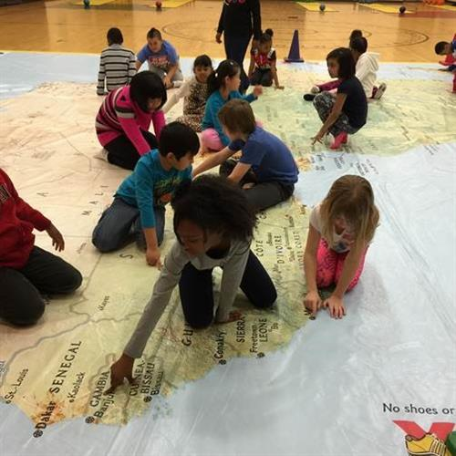 Students at Hebron Harman explored a National Geographic map of Africa to discover community and geographical connections.