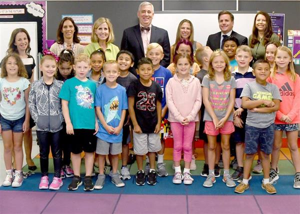 AACPS 2019 Teacher of the Year Teresa Beilstein stand with Dr. Arlotto, Board of Education Members, and her third-grade class