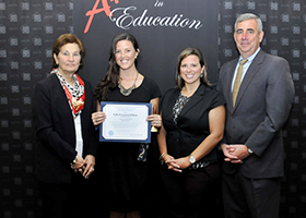 Board member Sasso, Teacher Sally Wilson, Principal Julia Walsh, and Superintendent Arlotto pose for award