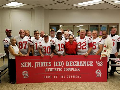 Group photo of some members of the 1967 Glen Burnie HS football team wearing white jerseys with red numbers