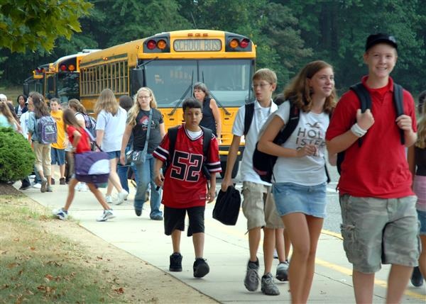 Image result for middle school kids walking to buses photos